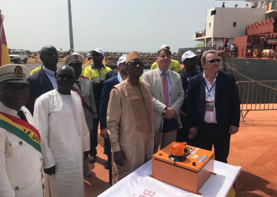 Guinea President Alpha Conde starting up the causeway conveyor belt.