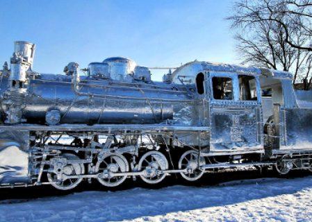 Polish Artist Encases Vintage Locomotive in Aluminium Foil
